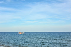 Fishing boat in the sea. And blue sky Royalty Free Stock Photo