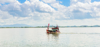 Fishing boat, sea and blue Sky in Kung Krabaen Bay Chathaburi. Province, Thailand stock photo