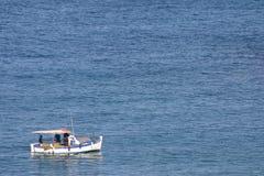Fishing boat. On sea. Blue and white. Fodele. Crete. Greece Stock Photo