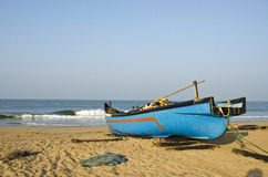 Fishing boat on sea coast beach in Karnataka, India Royalty Free Stock Photo
