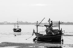 Fishing Boat at the Sea Coast Stock Images