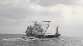 Fishing Boat in the Sea. A commercial fishing boat in the sea in slow motion stock video