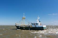 Fishing boat at sea royalty free stock images