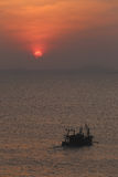 Fishing boat on sea in the evening and sunset. Stock Image
