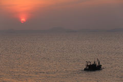 Fishing boat on sea in the evening and sunset. Stock Photo