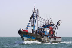 A fishing boat is at sea fishing. Royalty Free Stock Photography