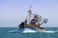 A fishing boat is at sea fishing. Royalty Free Stock Photos
