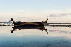 Fishing boat in the sea with morning light Royalty Free Stock Photos