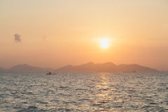Fishing boat in sea. Fishing boat in the sea In the morning, the sky began to brighten. And the sun rises stock photos