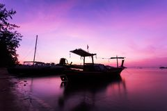 Fishing boat in the sea in morning time with scenery beautiful s royalty free stock photos