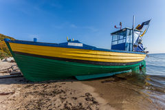 Fishing boat on sea shore in Gdynia - Orlowo, Poland Stock Image
