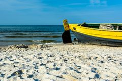 Fishing boat on the sea shore. Royalty Free Stock Image