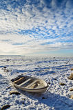 Fishing boat on the sea shore winter afternoon Stock Photo