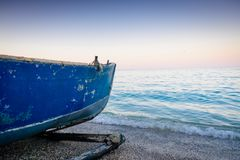Fishing boat on the sea side. Fishing boat left on the sea side Royalty Free Stock Photos