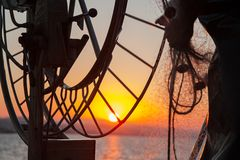 Fishing on boat in sea. Sunset Royalty Free Stock Photos