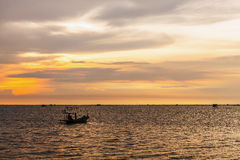 Fishing boat on the sea at sunset Stock Photography