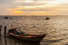 Fishing boat on the sea at sunset Royalty Free Stock Image