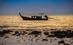 Fishing boat in sea. On sunset background Royalty Free Stock Photos