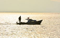 Fishing boat on the sea at sunset. Fisherman on the boat. Royalty Free Stock Photos