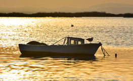 Fishing boat on the sea at sunset. Stock Photography