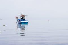 Fishing boat in sea Stock Photo