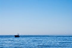 Fishing boat with seagulls in Baltic Stock Image