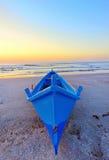 Fishing boat on the seashore at sunrise Royalty Free Stock Photo