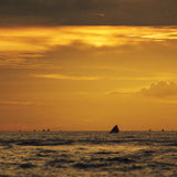 Fishing boat at senggigi beach when sunset with yellow atmosphere Stock Photography