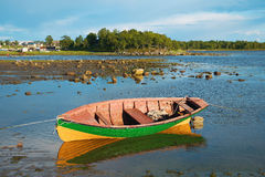 Fishing boat in the shallows Royalty Free Stock Image