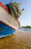 Fishing Boat in Shalow River Stock Photography