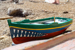 Fishing boat with shark's teeth. In Trapani port (Sicily, Italy Stock Image