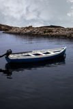 Fishing boat in a sheltered bay Royalty Free Stock Photo