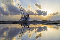 Wrecked boat abandoned stand on beach in RHodes Greece. Fishing boat shipwreck or abandoned shipwreck. , Wrecked boat abandoned stand on beach in RHodes Greece Royalty Free Stock Image
