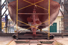 Fishing boat in a shipyard for maintenance. Lower part of stern and propeller detail of a fishing boat in a shipyard for maintenance Royalty Free Stock Image