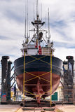 Fishing boat in a shipyard for maintenance. Stern view of a fishing boat in a shipyard for maintenance Royalty Free Stock Photos