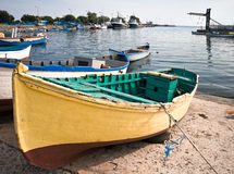 Fishing boat at the shore. An old yellow wooden fishing boat at the shore. Nessebur, Bulgaria Stock Image
