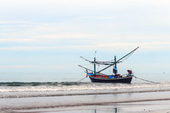 Fishing boat on the shore. Stock Photo