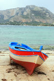 Fishing boat on the shore stock photos