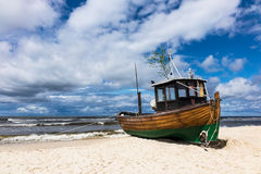A fishing boat on shore of the Baltic Sea in Ahlbeck Royalty Free Stock Photo