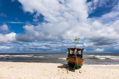 A fishing boat on shore of the Baltic Sea in Ahlbeck Royalty Free Stock Photos