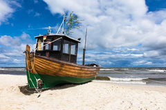 A fishing boat on shore of the Baltic Sea in Ahlbeck Royalty Free Stock Photography