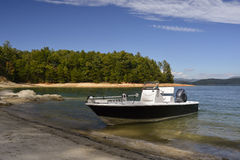 Fishing boat on the shore Stock Images