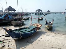Fishing boat on shore near the jetty in Angsila bay , Chonburi , Thailand Stock Photography