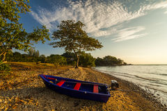 Fishing boat on the shore of a tropical island. Koh Chang. Royalty Free Stock Photography
