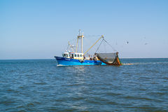 Fishing boat or shrimp trawler fishing on Waddensea, Netherlands Stock Image