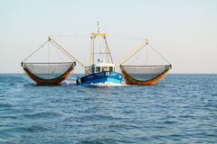Fishing boat or shrimp trawler fishing on Waddensea, Netherlands Royalty Free Stock Image