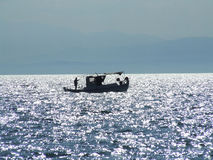 Fishing boat silhouette Stock Image