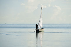 Fishing boat in silhouette in lagoon from Mauritius Royalty Free Stock Image