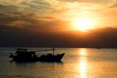 Fishing boat silhouette at sunset. Duong Dong. Phu Quoc. Vietnam Royalty Free Stock Image
