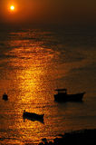 Fishing boat silhouettes Stock Photography